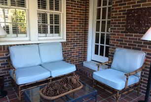 Traditional Porch with French doors, exterior brick floors