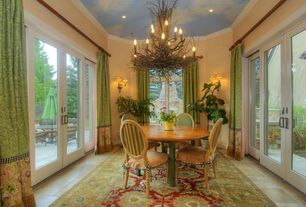 Eclectic Dining Room with French doors, High ceiling, limestone tile floors, Wall sconce, Crown molding, Chandelier