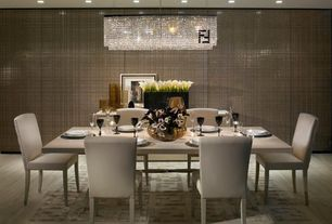 Modern Dining Room with Fendi Casa Crystal Chandelier, Fendi Casa Double F Ivory Area Rug, Hardwood floors, Pendant light
