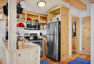 Cottage Kitchen with flush light, Farmhouse sink, specialty door, Flat panel cabinets, Wood counters, U-shaped, Exposed beam