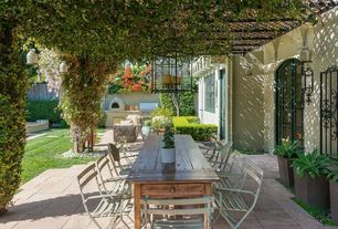 Mediterranean Porch with Pathway, Outdoor kitchen, outdoor pizza oven, exterior stone floors, Trellis, Fence, Raised beds