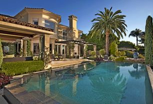 Mediterranean Swimming Pool with Lap pool, French doors, Gazebo, Trellis, picture window, Pathway, exterior stone floors