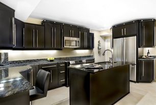 Modern Kitchen with European Cabinets, limestone tile floors, Kitchen island, U-shaped, Complex Granite, Inset cabinets
