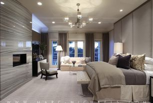 Contemporary Master Bedroom with stone fireplace, can lights, Glass panel door, Standard height, Crown molding, Chandelier