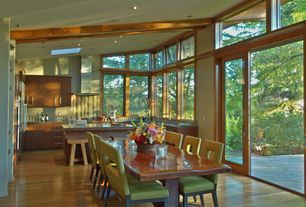 Contemporary Dining Room with Transom window, Built-in bookshelf, Hardwood floors