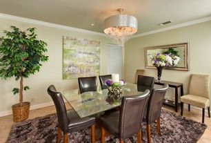Traditional Dining Room with limestone tile floors, Crown molding, can lights, Chandelier, Standard height, stone tile floors