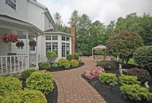 Traditional Landscape/Yard with Casement, exterior tile floors, exterior interlocking pavers, Arched window, Pathway