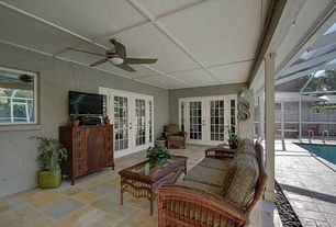 Traditional Porch with Fence, Outdoor seating, French doors, River rock patio accent, Exterior stucco, French sidelights