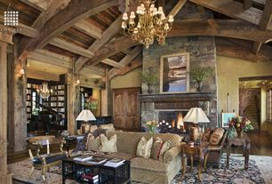 Country Living Room with stone fireplace, Built-in bookshelf, Exposed beam, HOGARTH SIDE TABLE, Chandelier, Wall sconce
