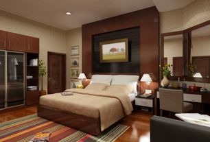 Contemporary Master Bedroom with Wood bed frame, Laminate floors, Striped area rug, specialty door, Wood panel wall