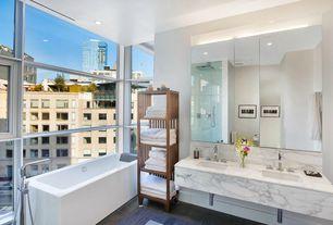 Contemporary Master Bathroom with Freestanding, Complex marble counters, Undermount sink, frameless showerdoor, Double sink