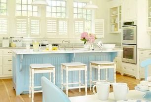 Cottage Kitchen with Simple granite counters, Wooden shutter blinds, Bar stools, Hardwood floors, Inset cabinets, Glass panel