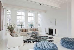 Modern Living Room with Crown molding, Wall sconce, Exposed beam, flush light, Hardwood floors