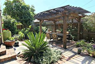 Rustic Patio with Fence, Raised beds, Pathway, Trellis, exterior brick floors