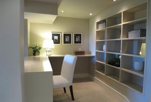 Contemporary Home Office with Built-in bookshelf, Standard height, Carpet, can lights