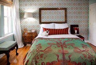 Eclectic Master Bedroom with double-hung window, six panel door, Hardwood floors, Pendant light, interior wallpaper