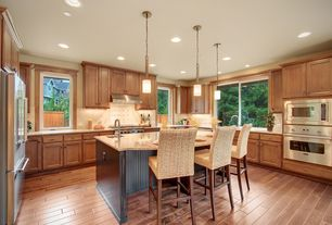 Traditional Kitchen with Inset cabinets, full backsplash, wall oven, Simple granite counters, Pendant light, Raised panel