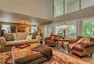 Traditional Living Room with Cathedral ceiling, specialty door, picture window, Brick floors