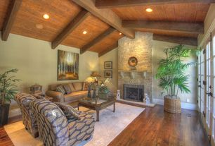 Mediterranean Living Room with Hardwood floors, French doors, stone fireplace, Exposed beam, High ceiling