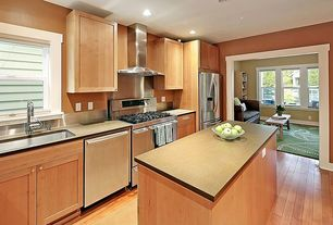 Contemporary Kitchen with dishwasher, double oven range, Wall Hood, can lights, Standard height, Undermount sink, Flush