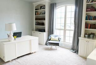 Traditional Home Office with Built-in bookshelf, Carpet, Arched window