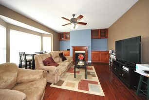 Traditional Game Room with metal fireplace, Ceiling fan, Serta dream convertible thomas sofa - light brown, Hardwood floors