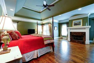 Traditional Master Bedroom with Tray ceiling, Bedding, stone fireplace, Crown molding, High ceiling, Ceiling fan