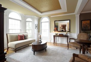 Traditional Living Room with Crown molding, Wainscotting, Arched window, Laminate floors