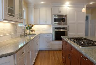 Traditional Kitchen with Limestone Tile, Flush, Simple granite counters, Kitchen island, Glass panel, Stone Tile, L-shaped
