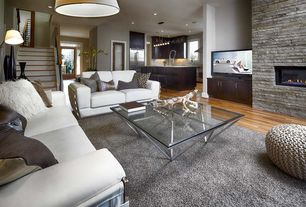Contemporary Great Room with Origami square coffee table, Built-in bookshelf, Wave sofas in white bonded leather