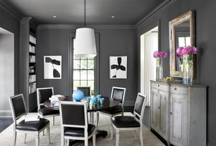 Contemporary Dining Room with Crown molding, double-hung window, can lights, Standard height, Pendant light, Hardwood floors