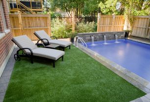 Modern Swimming Pool with exterior stone floors, Fence, Pathway, Lap pool, Fountain
