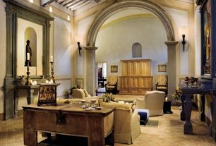 Mediterranean Living Room with limestone floors, Wainscotting, Exposed beam, Wall sconce, Crown molding, High ceiling