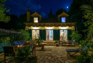 Cottage Patio with exterior stone floors, French doors, Louvered door, picture window, Pathway, Outdoor seating, Casement