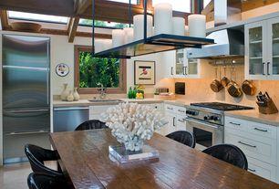 Craftsman Kitchen with Malibu black wicker outdoor chair (set of 2), Breakfast nook, limestone tile floors, Undermount sink