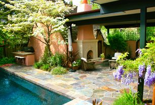 Traditional Patio with Outdoor kitchen, French doors, Fence, exterior stone floors, Lap pool, Pathway