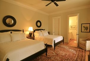 Traditional Guest Bedroom with Hardwood floors, Ceiling fan, specialty door, Crown molding