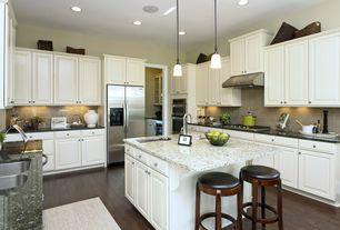 Traditional Kitchen with Subway Tile, Hardwood floors, U-shaped, Complex granite counters, Kitchen island, Raised panel