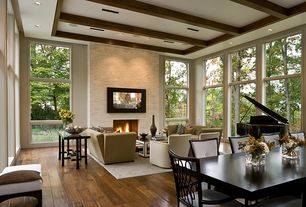 Contemporary Great Room with Exposed beam, Paint, picture window, Hardwood floors, can lights, stone fireplace, Fireplace