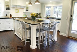 Traditional Kitchen with Paint, Farmhouse sink, Pendant light, Crown molding, gas range, Flat panel cabinets, Standard height