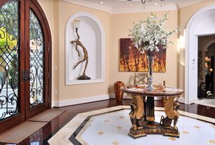 Mediterranean Entryway with Crown molding, simple marble floors, Laminate floors, French doors, Ceiling fan, Chandelier