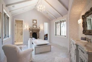 Traditional Master Bathroom with Limestone counters, can lights, Bathtub, Flat panel cabinets, Standard height, Freestanding