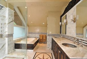 Traditional Master Bathroom with Wall Tiles, Raised panel, Undermount sink, Marble subway tile, drop in bathtub, Double sink