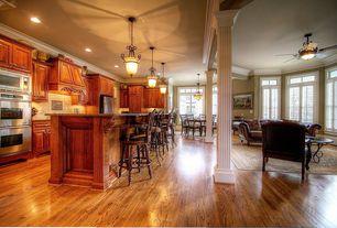 Traditional Great Room with Standard height, Pendant light, Crown molding, flush light, Hardwood floors, Casement, can lights