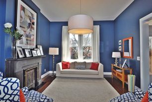 Traditional Living Room with Area rug, Pendant light, Hardwood floors, Console table, Painted fireplace
