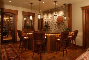 Craftsman Bar with Hardwood flooring, Glass panel door, Pendant light, Wood frame windows, Natural stone wall