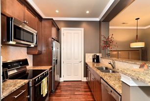 Contemporary Kitchen with Crown molding, Stone Tile, MS International - Giallo Atlantico Granite Countertop, specialty door