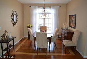 Traditional Dining Room with Hardwood floors, Seville linen dining chairs (set of 2), Chandelier, Arched window