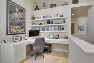 Contemporary Home Office with Standard height, Hardwood floors, can lights, Built-in bookshelf