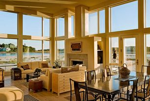 Contemporary Great Room with Cement fireplace, Fireplace, Built-in bookshelf, picture window, High ceiling, can lights